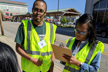 Volunteers in yellow vests doing a survey for Flint ReCAST