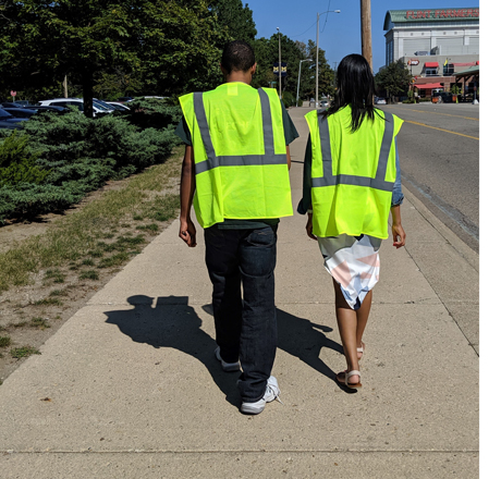 Volunteers walking in yellow vests to conduct surveys