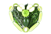 Image of green fruits and vegetables in the shape of a heart